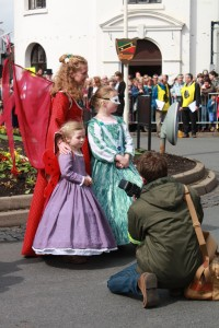 Photographer with costumed woman and 2 girls